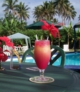 Colourful tropical cocktail on table by the pool
