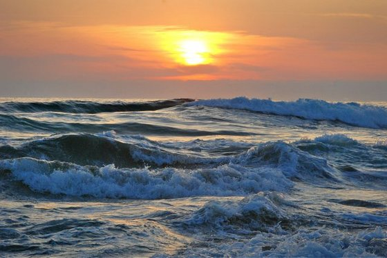 Big waves and setting sun