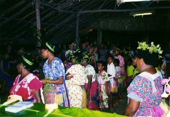 Islanders in colourful attire at Feast Night
