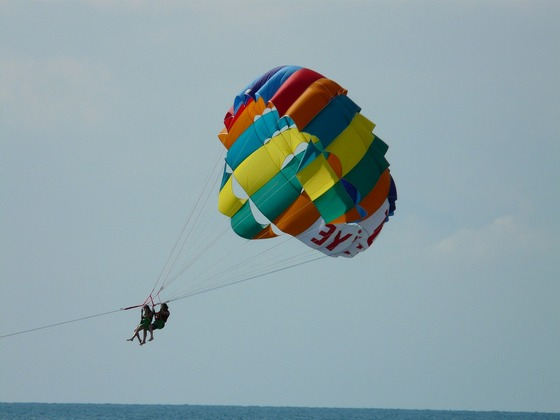 2 people parasailing on the sea