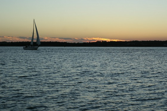 Sailing boat at sunset, in Pacific
