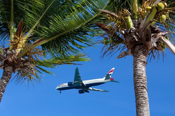 British Airways airplane flying in to a tropical island