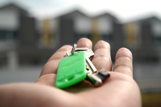 A person handing the keys to the buyer after buying a property in Vanuatu has been completed.