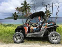 Man riding a buggy along coastline