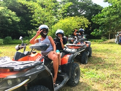 Family riding buggies in a jungle